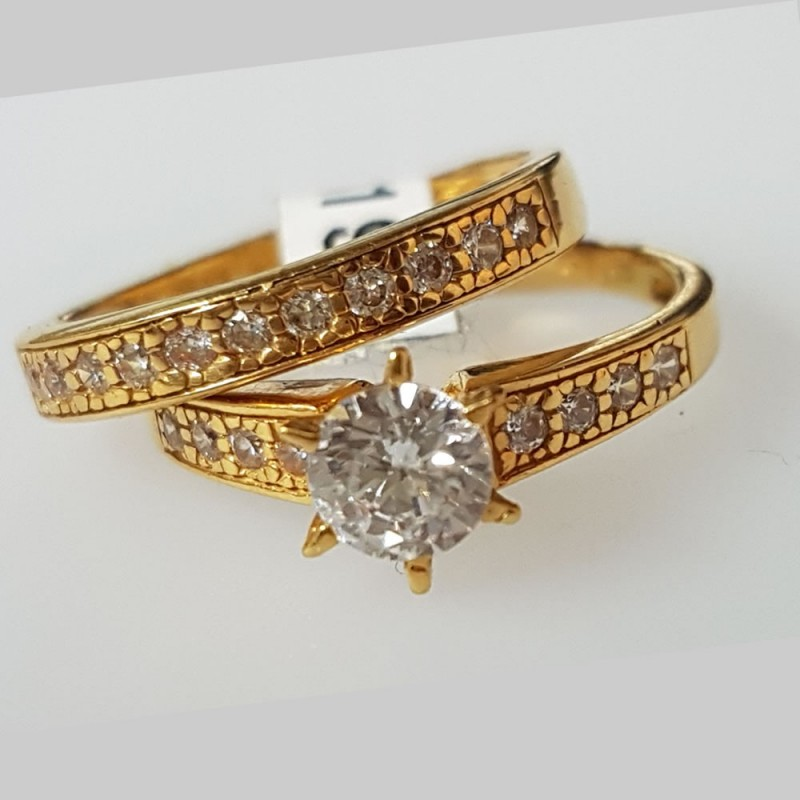 6claw engagement ring and half eternity band ring set in 22ct gold